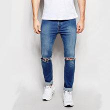 Модные мужские джинсы: рваный стиль с дырками